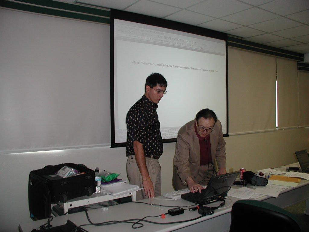 CW preparing PC for co-teaching presentation at training program for Universidad Interamericana de Puerto Rico